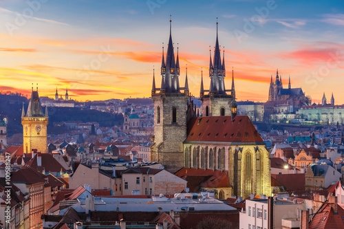 Aerial view over Church of Our Lady before Tyn, Old Town and Prague Castle at sunset in Prague, Czech Republic  © Kavalenkava