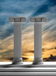 Two ancient pillars with sunset sky background.