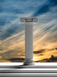 Ancient pillar with sunset sky background.