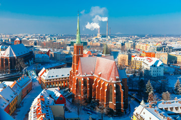 Aerial view of Ostrow Tumski with church of the Holy Cross and St. Bartholomew from Cathedral of St. John in the winter morning in Wroclaw, Poland