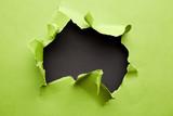 Torn green paper
