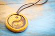 Постер, плакат: aromatherapy yin and yang pendant