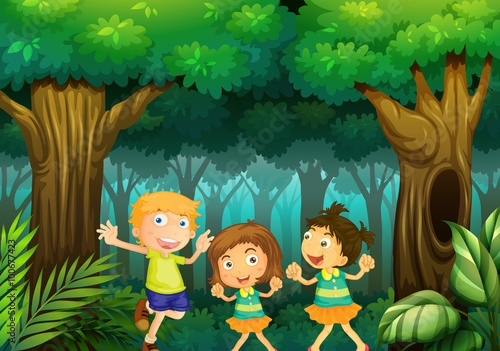 Three kids dancing in the forest