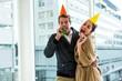 Obrazy na płótnie, fototapety, zdjęcia, fotoobrazy drukowane : Cheerful couple celebrating birthday against glass window