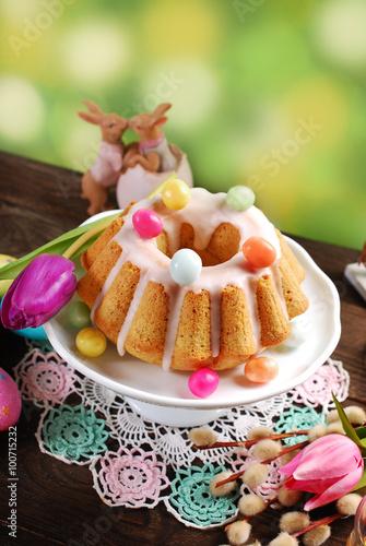 Fototapeta easter almond ring cake on wooden table