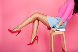 Female legs with red heels - 100738826