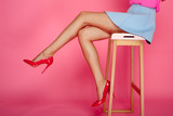 Female legs with red...