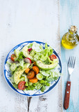Healthy avocado and vegetables salad with radish,onions,lettuce