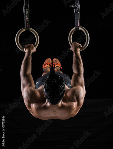 Plagát, Obraz Body Builder on Gym Rings