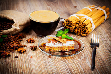 Coffee and dessert on wooden background