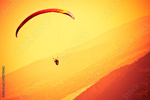 Fototapeta Paragliders passion is paragliding at the sky