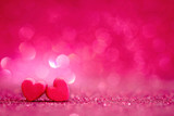 Fototapety red Heart shapes on abstract light glitter background in love co