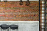 cement counter nightclub with seat bar stool and brick wall