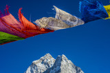 Prayer flags in the Himalayas with Ama Dablam peak in the backgr