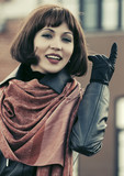 Happy beautiful fashion woman in leather coat