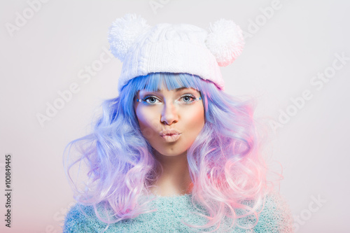 Cute young fashion woman with pastel purple and pink hair and makeup