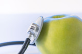 Green apple and stethoscope.