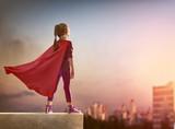 Fototapety girl plays superhero