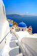 Scenic view of white houses and blue domes in Santorini