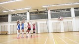 group of girls playing volleyball sport in gym