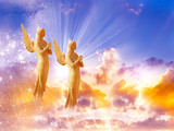 two gold sunny angels with rays of light