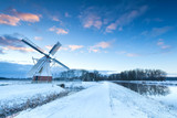 Dutch windmill in snow winter