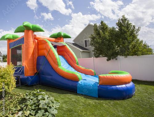 Water Slide In Backyard inflatable bounce house water slide in the backyard | buy photos