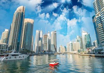 Buildings and skyline of Dubai Marina at dusk