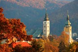 Autumn trees and historical tower buildings in Slovakia