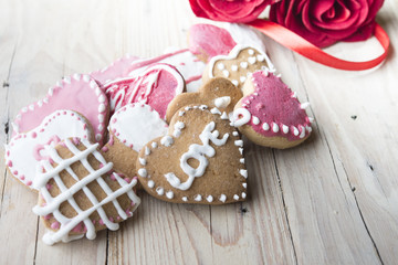 Festive cookies with hearts and roses for Valentine's Day.