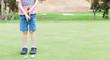 kid playing golf