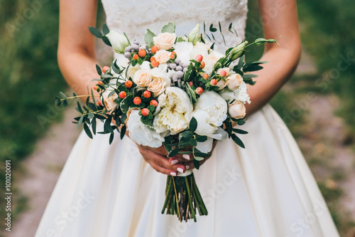 Plakát bride holding a bouquet of flowers in a rustic style, wedding bouquet