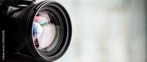 Leinwanddruck Bild Close-up of a digital camera. Large copyspace