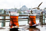 Turkish tea cup on the background of port in Istanbul