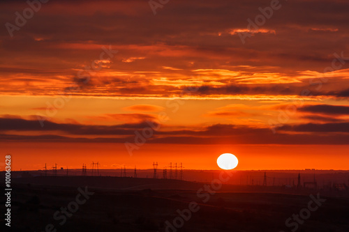 Poster Oranje eclat Beautiful sunset with factory electricity on horizon