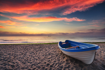 Fototapet łódź i zachód słońca