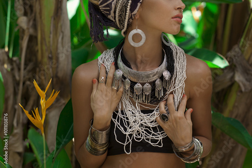 Fashion model posing outdoors with jungle background - 101103876