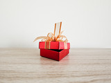 red gift box with  ribbon  on background