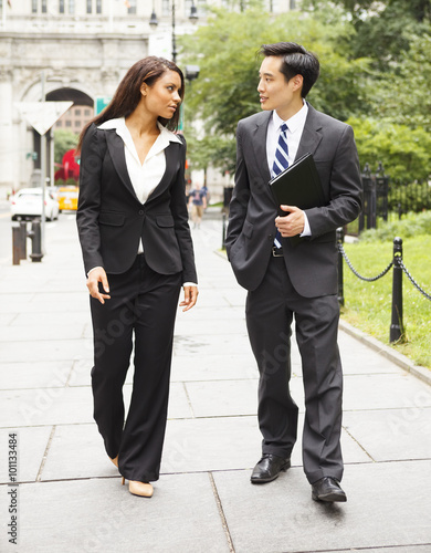 """""""Two well dressed professionals walking down a city street ..."""