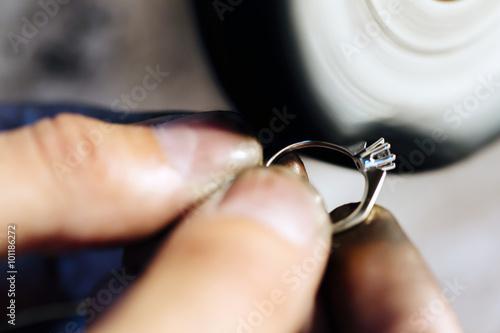 Jeweler polishing jewelry © nd3000