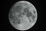 Fototapety Growing big moon taken with telescope in black background.