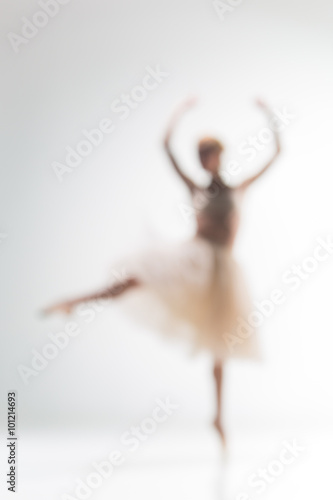 Vászonkép Blurred silhouette of ballerina on white background