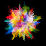 Fototapety Explosion of colored powder on black background
