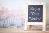 Concept Enjoy The Weekend message on wood boards