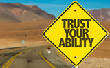 Trust Your Ability sign on desert road