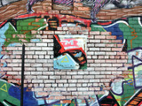 Colorful brick wall with scraps of paint and graffiti - landscape photo