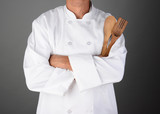 Chef Holding Wood Utensils
