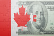 puzzle with the national flag of canada and dollar banknote