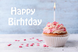 Fototapety Delicious birthday cupcake on wooden background