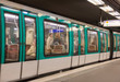 Metro train in a Paris station, France